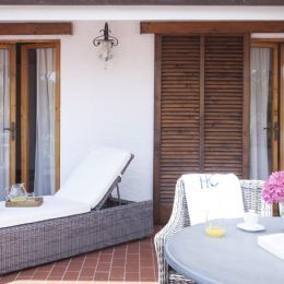 Large terrace with table and sunbed