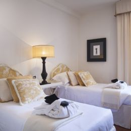 Room with two comfortable single beds